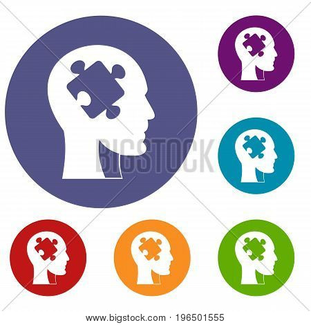 Head with puzzle icons set in flat circle red, blue and green color for web