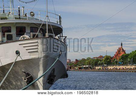 RIVER BOAT - Small ship moored at the embankment of a promenade