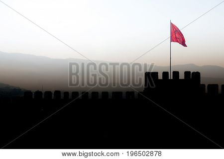 Panorama With Silhouette Of Ayasoluk Castle Walls With Turkish Flag In Selcuk Near Ephesus In Turkey