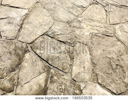 Stone pavement texture. Granite cobblestoned pavement background. Abstract background of old cobblestone pavement close-up. Seamless pavement texture