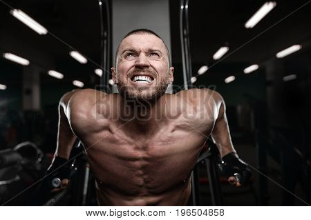 Muscular Handsome Athletic Bodybuilder Fitness Model Posing After Exercises In Gym On Diet .