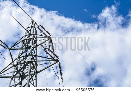 Power pole in nature for energy with blue sky in background