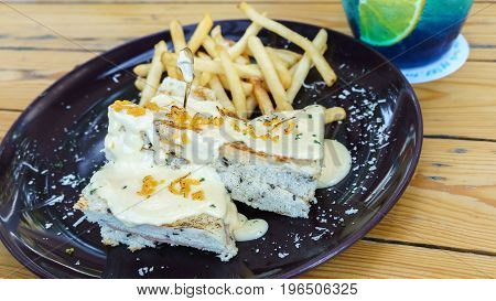 Delicious ham sandwich topping with homemade mayonnaise served with french fries