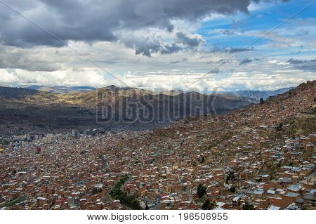 The city of La Paz seen from El Alto and the surrounding mountains on the background in Bolivia South America