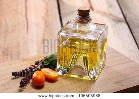 Homemade orange liqueur on a wooden table. Selective focus