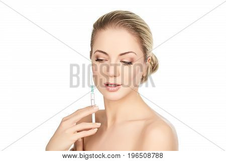 beautiful happy young woman holding syringe with collagen treatment injection. beauty shot isolated on white background. copy space.