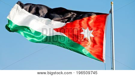 In Jordan The National Flag In The Wind