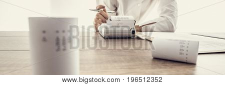 Low Angle Wide View Of A Woman Doing Calculations