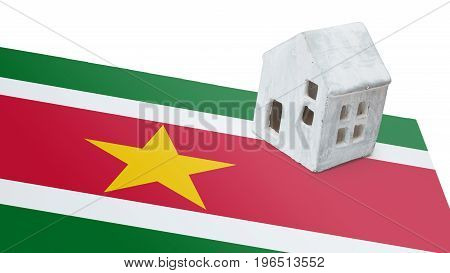 Small House On A Flag - Suriname