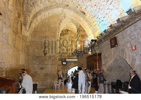 JERUSALEM, ISRAEL - June 15, 2017: religious jews, pray in the synagogue at the Wailing Wall ( Western Wall or Kotel ), Old City of Jerusalem, Israel