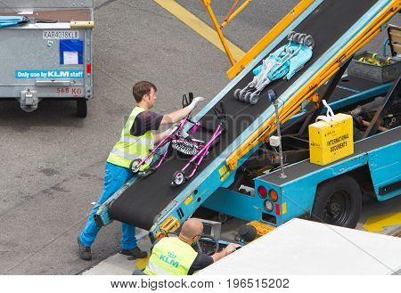 Amsterdam, Netherlands - June 29, 2017: Loading Luggage In Airplane At Amsterdam Schiphol Airport, N