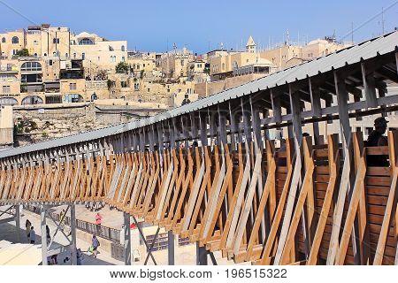 JERUSALEM, ISRAEL - June 15, 2017: Mughrabi Bridge, a wooden bridge connecting the Wailing Wall area with the Mughrabi Gate of the Temple Mount in Jerusalem, Israel