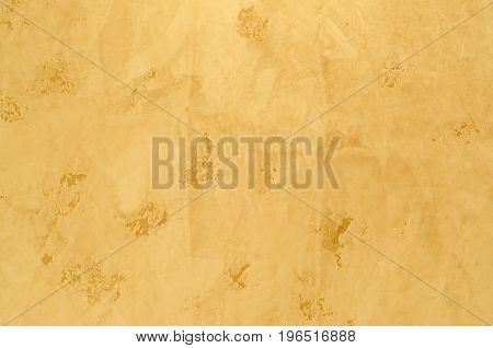 Textured background. Decorative plaster walls, external decoration of facade. Texture of beige.