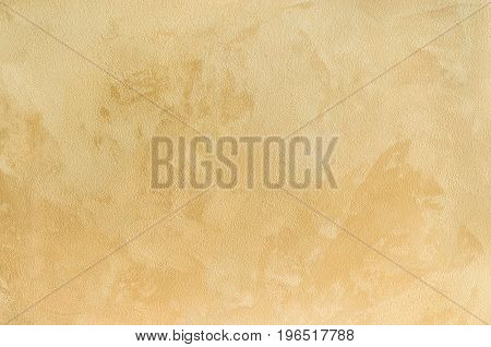 Textured background. Decorative plaster walls, external decoration of facade. Texture of beige.
