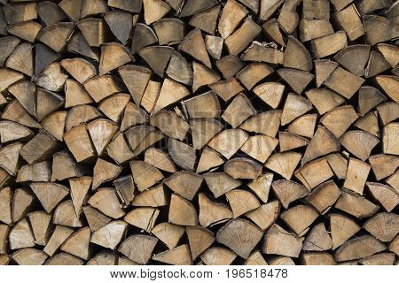 Firewood ready for winter. Wooden background - texture