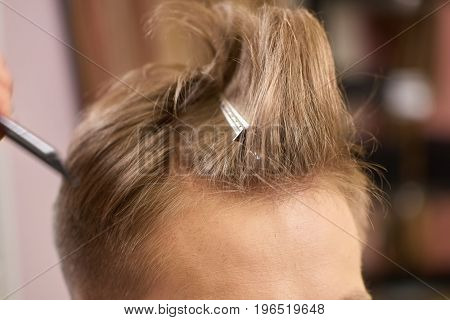 Hair of man close up. Head and hairpin. Medium mohawk hairstyle.