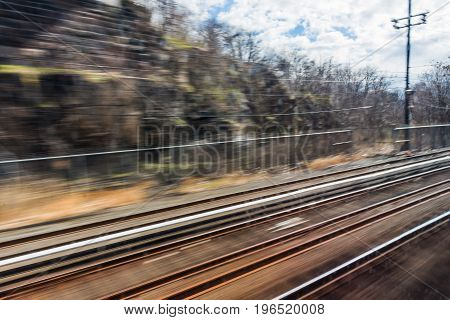 A motion blur view of train tracks as seen from the train.