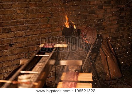 Handcrafted barbecue firing coal ready to cook lamb skewers
