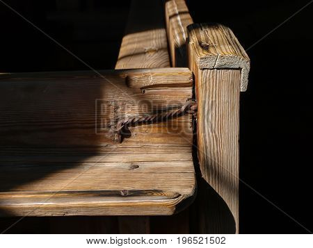 Old wooden church bench Close up in detail
