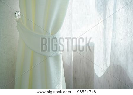 Romantic morning light thru a window with white curtain
