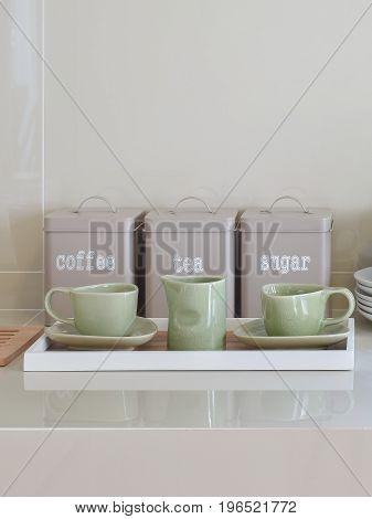 modern pantry with ceramic utensils in kitchen