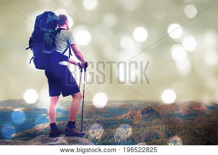 Film Effect. Hiker With Big Backpack Stand On Rocky View Point Above Misty Valley.