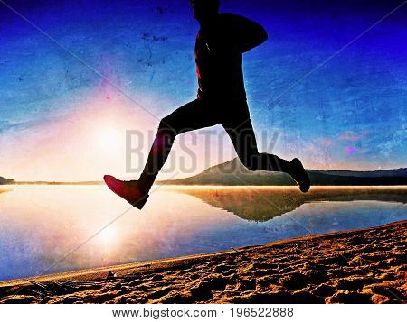 Film Effect. Sportsman  Running At Amazing Summer Sunset Along Coastline In Sport And Healthy Lifest