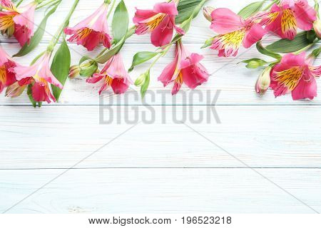 Pink Alstroemeria Flowers On White Wooden Table