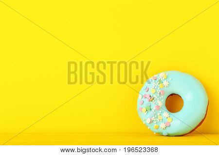Tasty Donut With Sprinkles On Yellow Background
