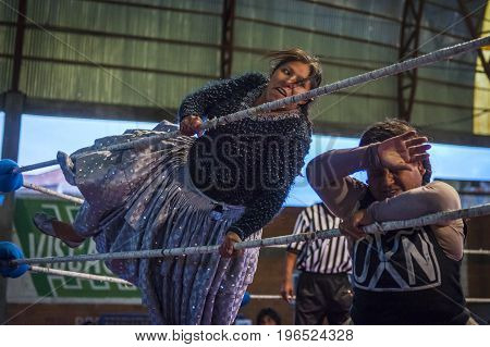 El Alto Bolivia - December 8 2013: Cholita wrestlers during a wrestling fight in the city of El Alto Bolivia. The Fighting Cholitas are a group of female wrestlers.