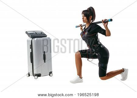 Woman In Ems Suit Doing Lunge Exercise