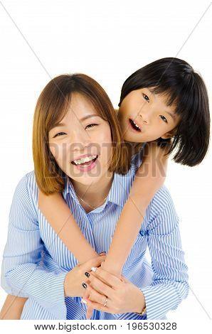 Asian mother and her daughter indoor portrait