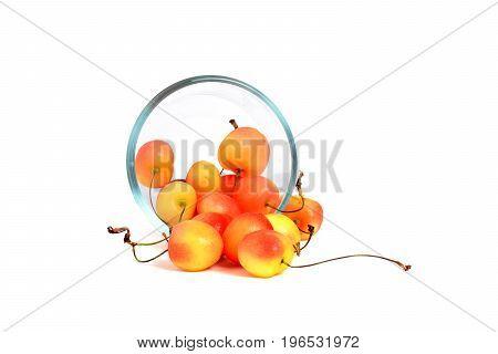 rainier cherries in a glass bowl white background