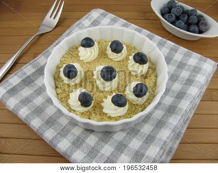 Blueberries and fresh quark cream with crumbles