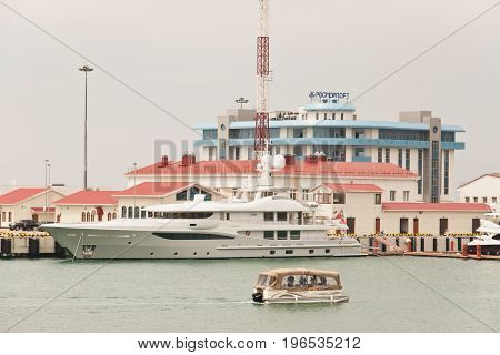 Sochi Russia - May 4 2017: Large boat and small boat on the background of the building of Rosmorport Sochi