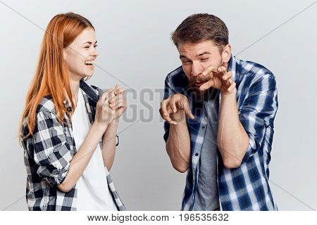 Young beautiful woman with a guy with a beard on white isolated background, repair, construction tools.