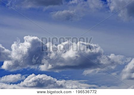 Large rain clouds on a blue sky, background, close-up