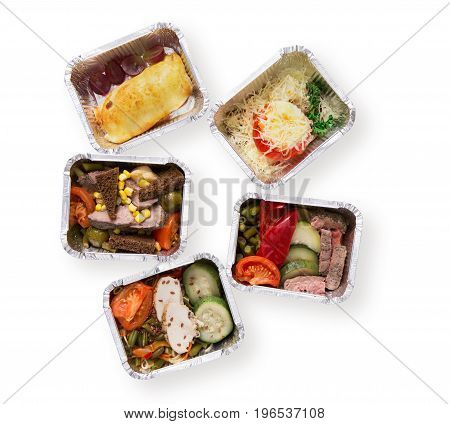 Healthy food delivery isolated at white background. Eating right concept. Fresh diet daily meals in lunch foil boxes. Vegetables, meat and dessert top view