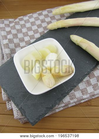 Fresh white asparagus spears and cutted pieces