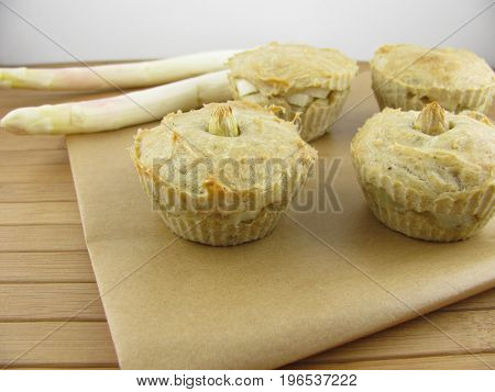 Baked muffins with fresh white asparagus pieces