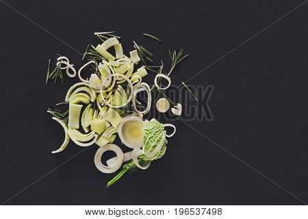 Cooking healthy food. Sliced and chopped leek on dark background