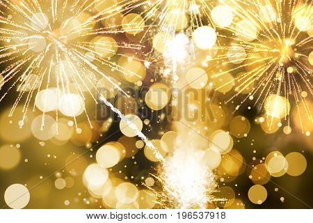 Abstract background. Gold-colored blur. Fireworks circle blur
