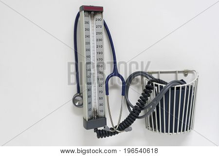 Stethoscope and a sphygmomanometer on the wall in doctor clinic