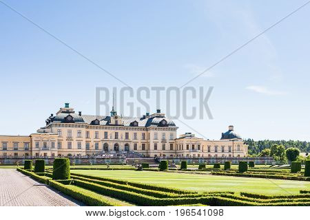 View over Drottningholm Palace and park on a sunny summer day. Home residence of the Swedish royal family. Famous landmark and tourist destination in Stockholm Sweden