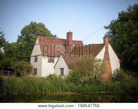 vintage impression of willy lotts' cottage on a summer's day in constable country; Suffolk; England; UK