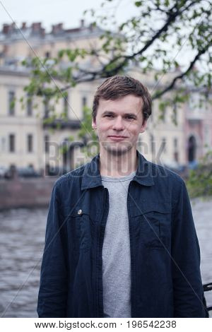 Portrait of young man in St. Petersburg city.