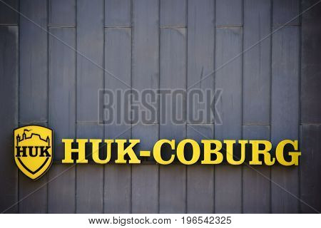 MAINZ, GERMANY - 16 JULY: The yellow company logo of the insurance company HUK Coburg on a metal facade of an office building on July 06 2017 in Mainz.