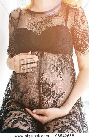 Beautiful adult pregnant woman. Waiting for the baby. Pregnancy. Care, tenderness motherhood