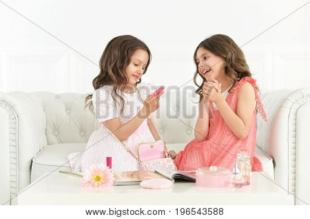 Portrait of two cute little girls playing together