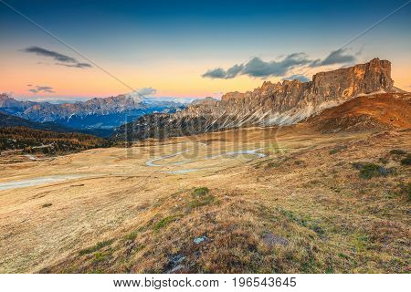 Stunning autumn landscape alpine pass and high mountains Passo Giau with famous Croda Da Lago peaks in background Dolomites Italy Europe